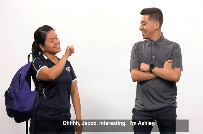 Two students using sign language